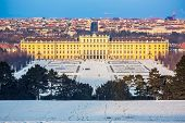 VIENNA - DECEMBER 13 2012: Schonbrunn Palace, Vienna, Austria illuminated by sunset on December 13, 2012. The 1441-room palace is the major tourist attraction in Austria since 1960s.