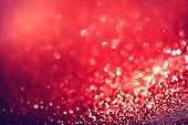 Christmas Background. Red Holiday glowing Abstract Glitter Defocused Background With Blinking Stars. Blurred Bokeh