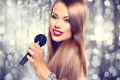 stock photo of singing  - Singing Woman - JPG