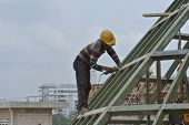 Construction workers grinding metal surface