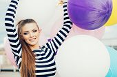 image of latex woman  - Happy young woman with colorful latex balloons outdoor - JPG
