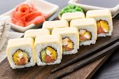 Sushi roll with chiken, tomato and cheese