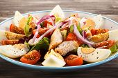 Boiled eggs with roast chicken fillet and vegetables