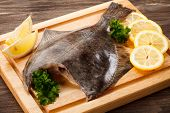 Fresh raw flounder on cutting board