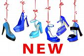 Blue fashion women's  shoes hang on ribbon.New