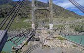 View Through The Old Bridge Over Mountain River.