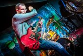 stock photo of rocking  - Band performs on stage - JPG