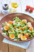Salad with salmon, quail eggs, cherry tomatoes and red caviar