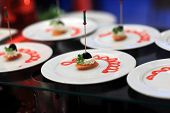 picture of buffet  - Carrot cream canape on a plate at the buffet