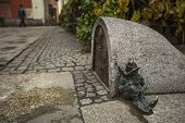 WROCLAW, POLAND - NOV 6, 2014: Small figurines dwarfs, appeared in the streets of city in 2001, their numbers have been continually growing. Wroclaw is going to be European Capital of Culture in 2016.