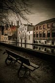 Bench near canal in Bruges, Belgium