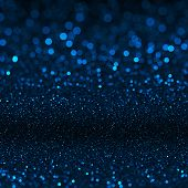 Blue bokeh texture. Festive glitter background with defocused lights