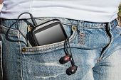 Woman With Smartphone And Headphones In Her Pants Pocket