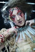 Young woman with creative make up. Halloween theme. Zombie theme.