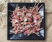 slices of ham with toothpicks
