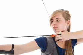 pic of longbow  - Young girl with blue shirt aiming with a longbow in closeup - JPG