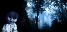 foto of evil  - Vintage evil spooky doll and mysterious landscape of foggy forest  - JPG