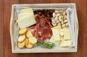 foto of cheese platter  - cheese platter on tray on brown wooden background - JPG