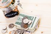 pic of american money  - Saving money into glass jar for future investment - JPG