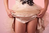 picture of garter-belt  - Woman in elegant clothing shows underwear on pink background - JPG