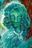 foto of creatures  - Beautiful colorful painting of a radiant elven creatures and energy lights fantasy emerald green fairy portrait colorful close up painting eye contact - JPG