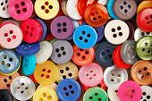foto of sewing  - variety of colorful sewing buttons full frame - JPG