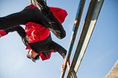 pic of parkour  - Parkour athlete jumping over a handrail  - JPG