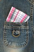 pic of chessboard  - soft focus image of pink chessboard pattern handkerchief is in pocket of jeans shirt - JPG