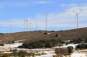 Aerogenerator Electric Windmills On Snow Mountain