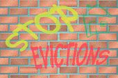 stock photo of eviction  - Illustration of a Wall with Stop Evictions - JPG