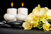 picture of yellow orchid  - beautiful spa background of yellow orchid phalaenopsis and candles on black zen stones with drops closeup - JPG