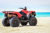 image of caribbean  - Quad vehicle on empty caribbean beach against caribbean sea background - JPG