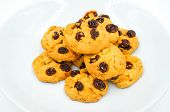 foto of baked raisin cookies  - Raisin and cornflake cookies on white background - JPG
