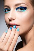 image of nail-design  - Beautiful girl with bright creative fashion makeup and blue nail polish - JPG