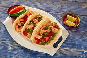 stock photo of poblano  - Camaron shrimp tacos mexican food on blue wood table - JPG