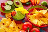foto of nachos  - Mexican food nachos and guacamole with chili peppers and sauces - JPG