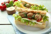 foto of meatball  - Homemade Spicy Meatball Sub Sandwich on plate - JPG