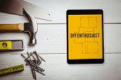 picture of enthusiastic  - The word diy enthusiast and tablet pc against blueprint - JPG