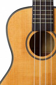 picture of string instrument  - Small Hawaiian four stringed ukulele guitar isolated on white background with clipping path - JPG
