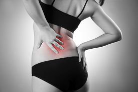 picture of sick kidney  - Woman with backache - JPG