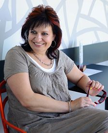 picture of ordinary woman  - Portrait of the european caucasian middle aged woman sit on the chair in the cafe - JPG
