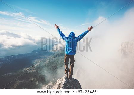 poster of Man Traveler on mountain summit enjoying aerial view hands raised over clouds Travel Lifestyle success concept adventure active vacations outdoor happiness freedom emotions