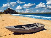 Fishing boat on seashore.