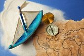 Wooden boat, compass and old map on blue background. Columbus Day concept poster