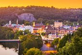 Frankfort, Kentucky, USA town skyline on the Kentucky River at dusk. poster