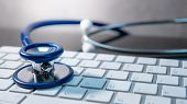 Medical Science Technology Concept. Blue Stethoscope On White Modern Keyboard On Doctor Desk. Health poster