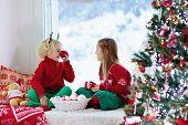 Kids Decorate Christmas Tree. Child On Xmas Eve. poster