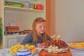 Little Girl Looking On Her Birthday Cake. Small Girl Celebrating  Her Six Birthday. Birthday Cake An poster