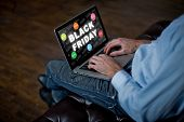 Man Buys Online On Black Friday. Man With A Laptop, An Adult Mans Hands On A Keyboard. Sale In Blac poster