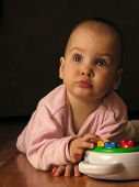 Baby With Toy poster